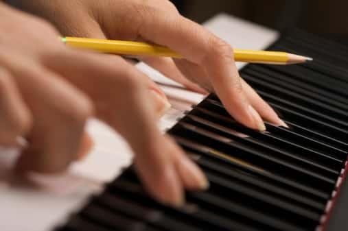Woman's Fingers on Digital Piano Keys