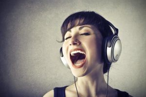 woman singing headphones